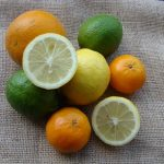 Composition of citrus fruits photographed on a coffee sack