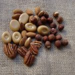 A composition of nuts and caramel sweets on a coffee sack