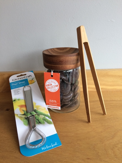 Three kitchen tools: jar, tongs and whisk